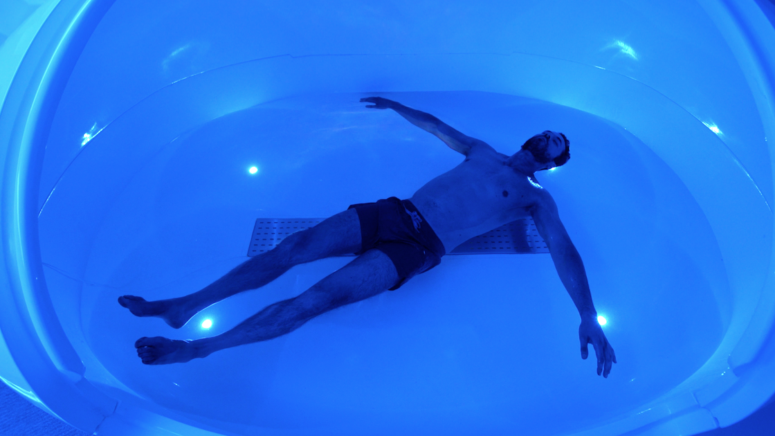 Man in floatation tank